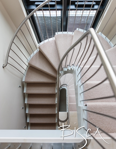 Bespoke helical carpeted staircase by Bisca.  Understated elegance and simple modern look