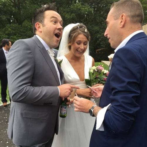 Adam performing at a wedding