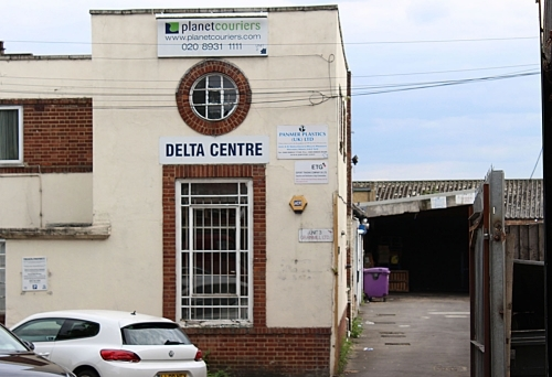 This is a straight view of the Delta Centre building where Planet Couriers Ltd is located.