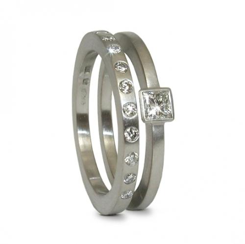 Platinum diamond engagement ring with platinum diamond wedding ring