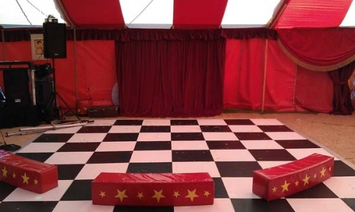 dance floor, dj and stage area for circus party
