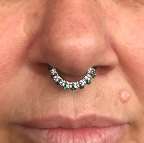 Healed septum piercing by Mara, installed with the Aphrodite clicker from Industrial Strength.