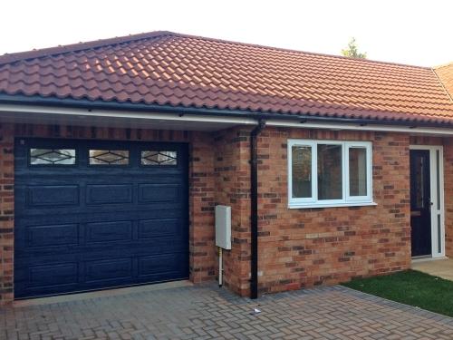 Blue sectional Garage Door with Rhombus windows