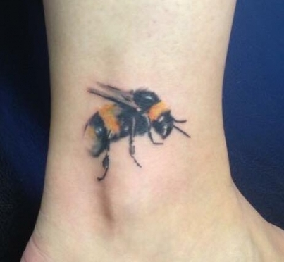 Bumble bee tattoo by Tyson