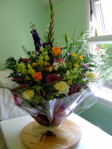 Wild and pretty this summer wet wrap makes a gift for any occasion.from £28