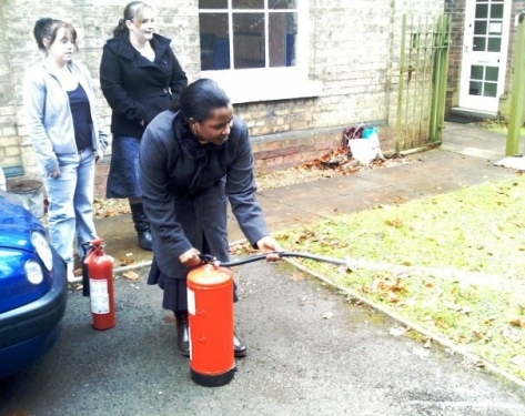 Aiming a water extinguisher in Rugby.
