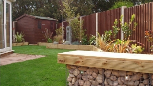 Softwood deck seatin on cornish cobble filled gabions with LED lighting