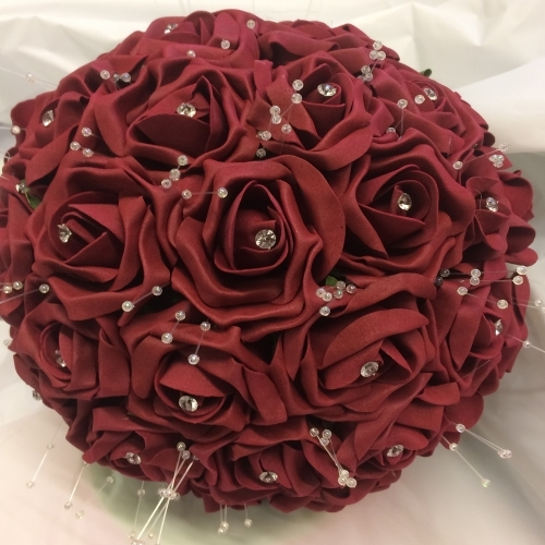 a burgundy Bouquet featuring crystals and dainty pearls