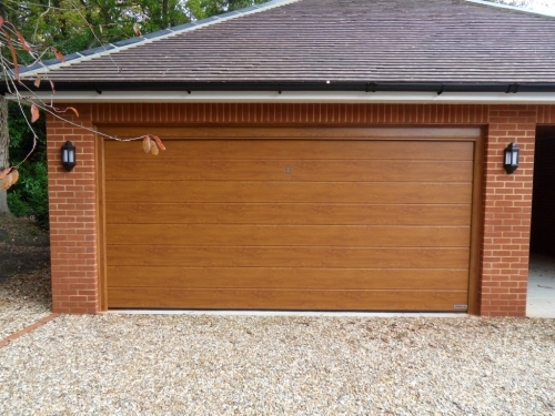 Golden Oak M Rib Sectional Door Installed in Farnham, Surrey
