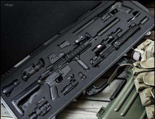 Airsoft Guns and Apatures all secured in the case ready to use/close and lock away safely
