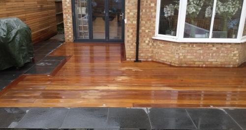 Hardwood decking with granite paving