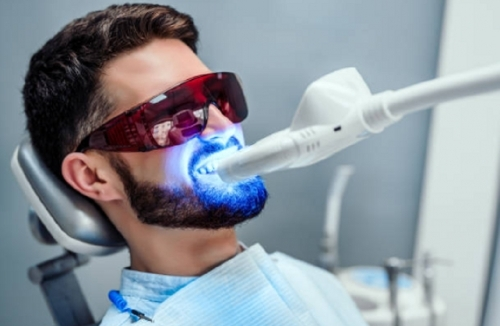 Man Getting Teeth Whitening Treatment