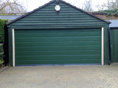 Doco grooved Sectional Garage Door in bespoke green