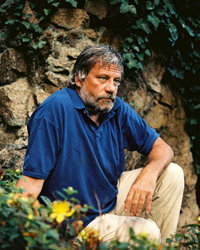 The infamous Oliver Reed pictured in his garden in Guernsey.