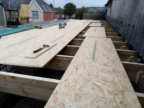Flat Roof Decking OSB3 T+G Boards in Newport.